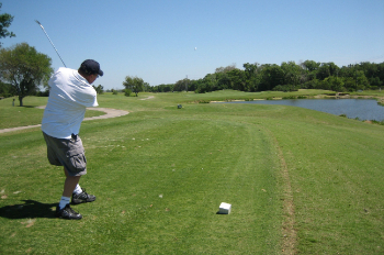 A man admires his shot on the course at Buffalo Creek
